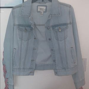 Jean jacket with red ribbon